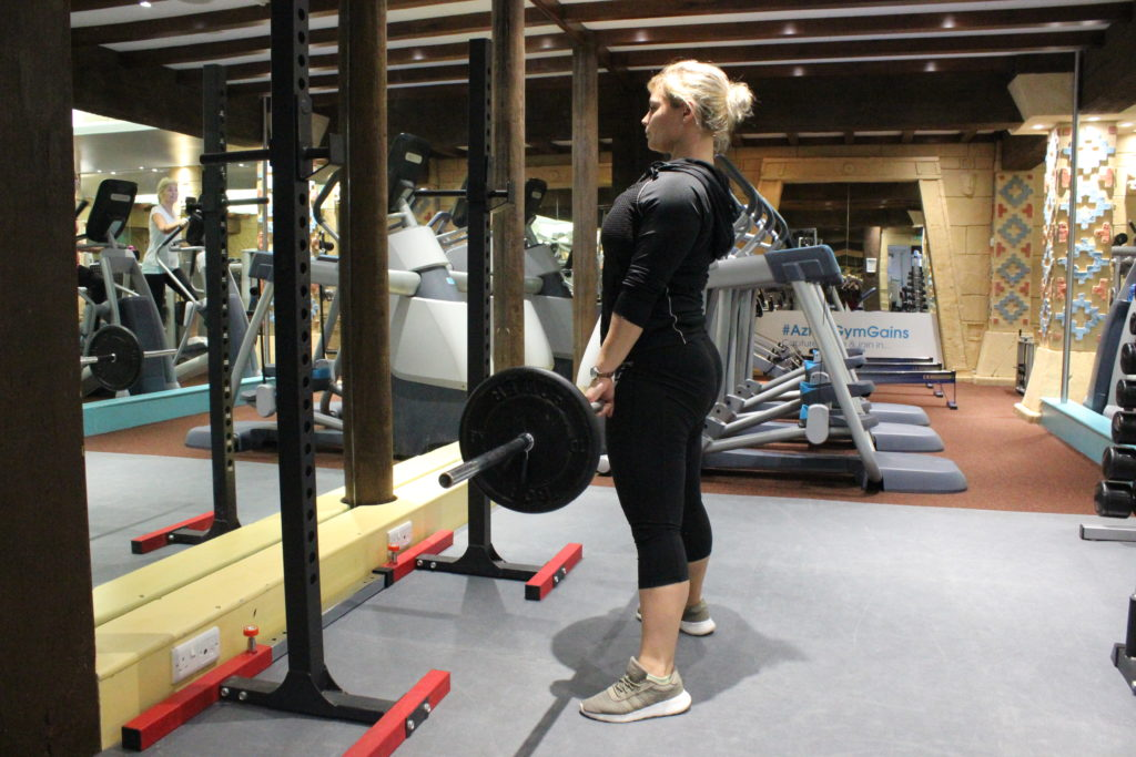 Deadlift using weighted barbell